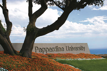 Pepperdine University sign besides a large tree