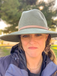 Seaver alumna Charlotte Gaetz pictured in a hat