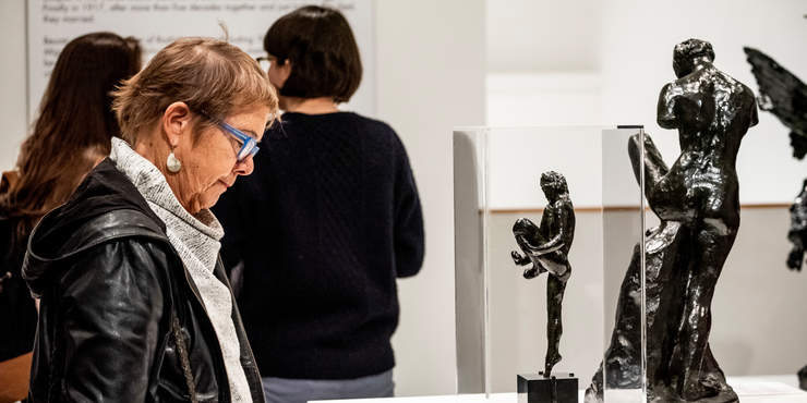 Female looking at a charcoal statue at the Weisman museum