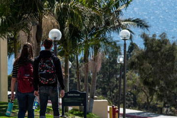 Students walking down Seaver's Malibu campus