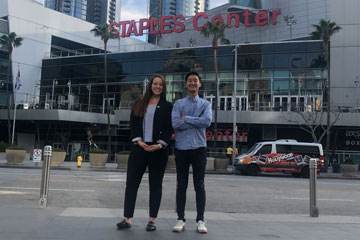 Seaver students Caitlin Fogg and Daniel Lee standing in front of the Staples Center