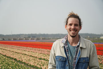Seaver Senior Cullen Player pictured in a field of tulips