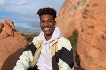Justus Johnson pictured among red rocks