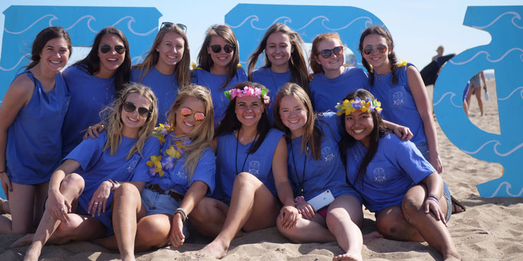 Lanies Jones and her sorority sisters gathered together at the beach wearing matching blue shirts