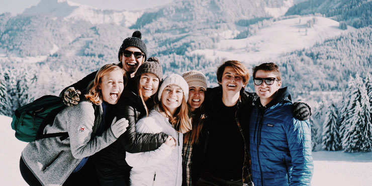 Millie Vieira pictured among snow-covered mountains with a group of Seaver students