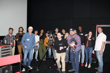 Professor Germano Saracco and his cinematography students posing for a photo at RED Studios