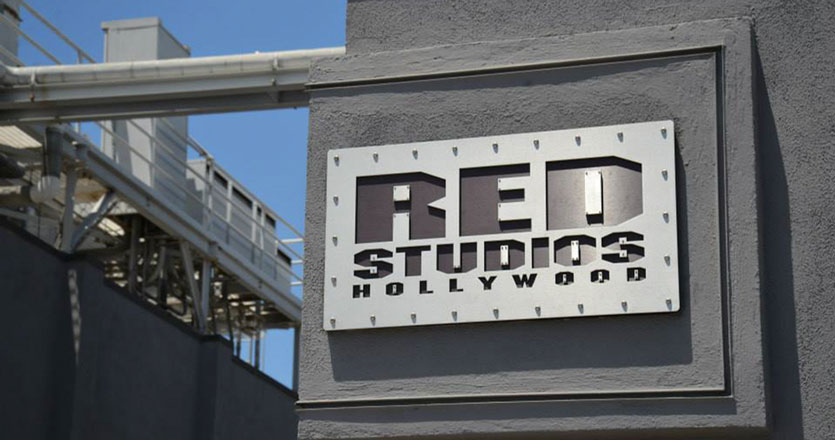 RED Studios sign on a gray concrete wall