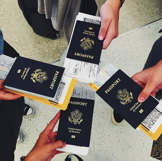 Seaver students traveling abroad with their passports
