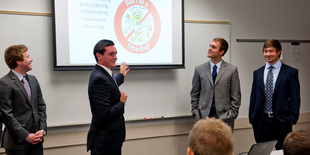 Students give a formal marketing presentation
