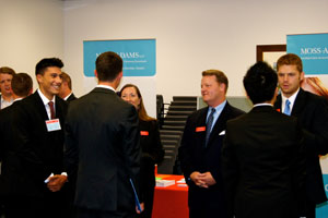 Group of students talking with professionals at a job fair