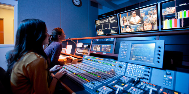 Media production majors work with video editing equipment - Media Production Degree