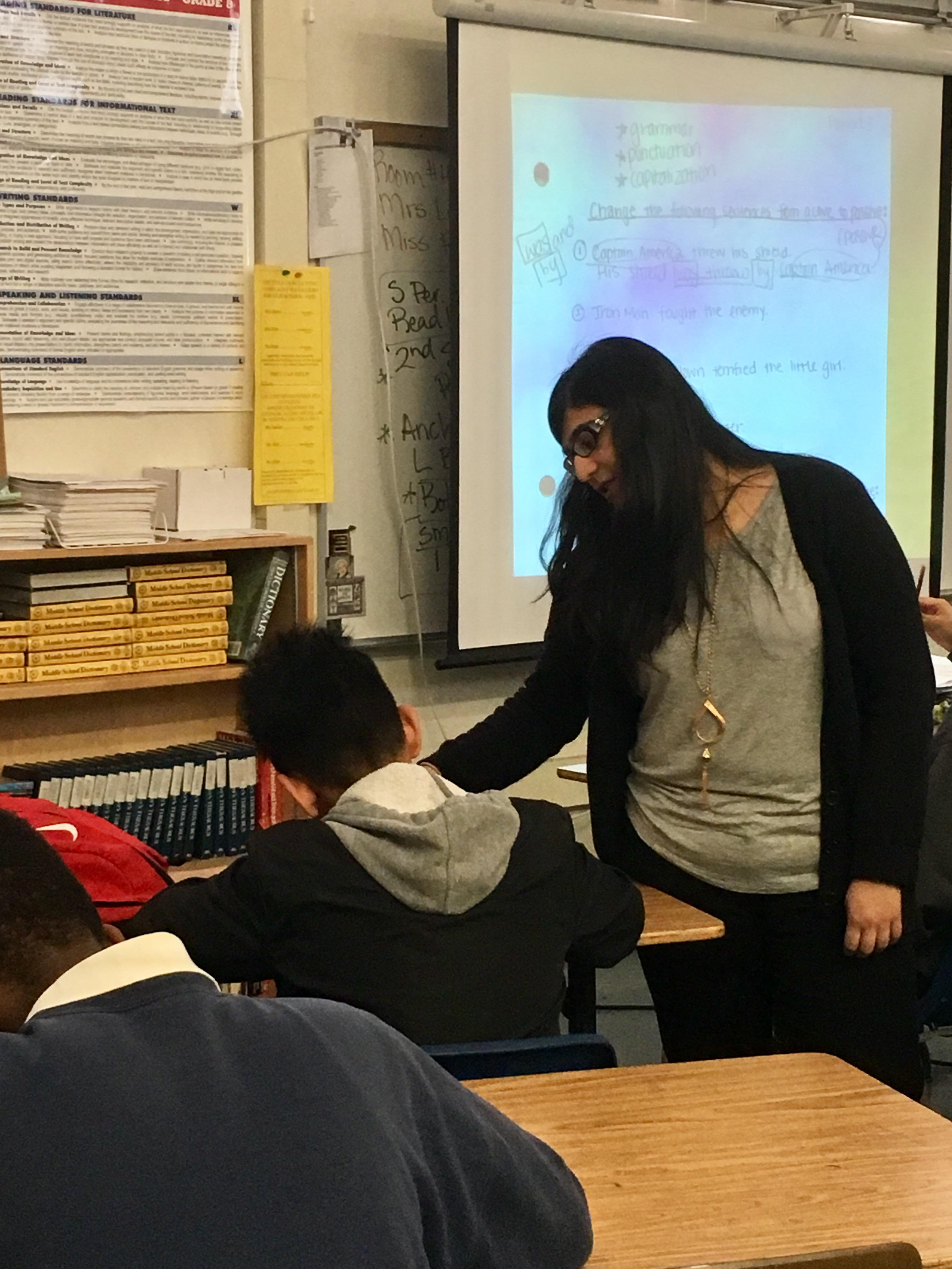 Teacher candidate assisting a student