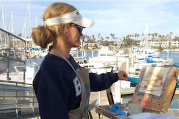 Shannon Cella painting on the harbor