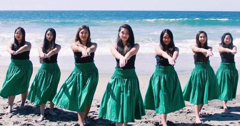 Hula dancers dancing at the beach