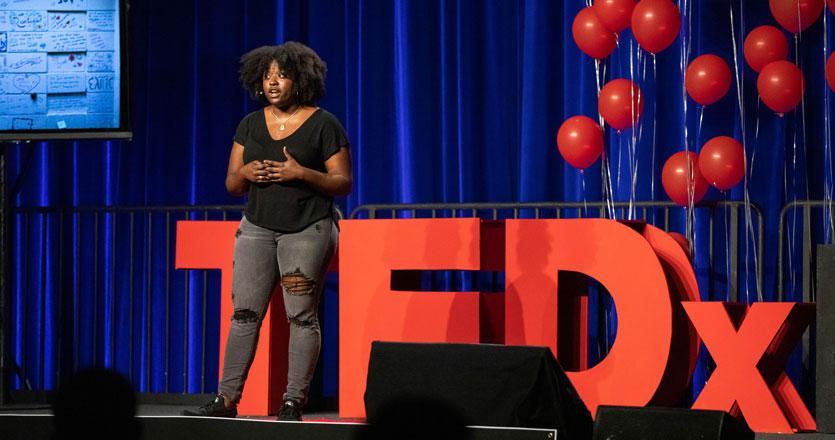Danielle Harris presenting at TEDx