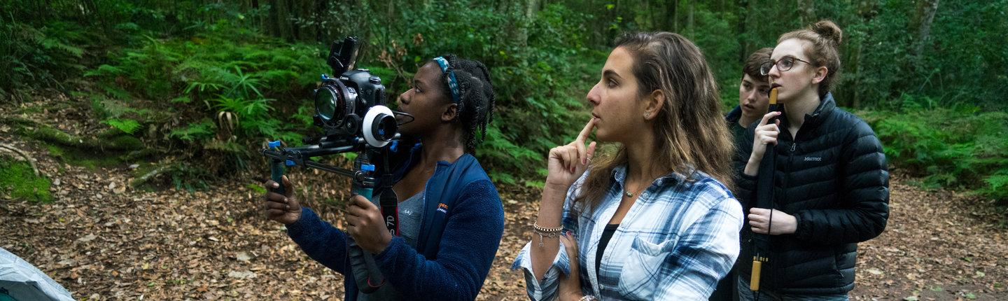 Students filming a short film in the forest