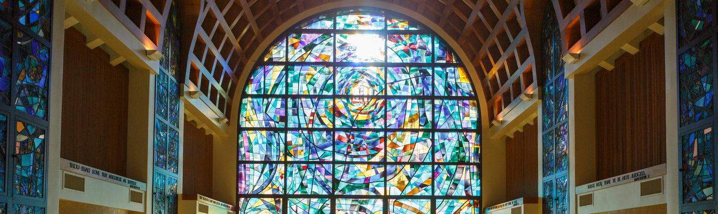 Stained glass windows inside of Stauffer Chapel