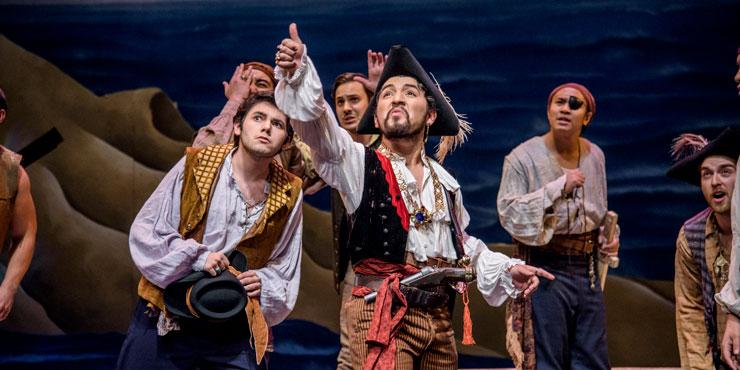 Opera students dressed as pirates performing on stage