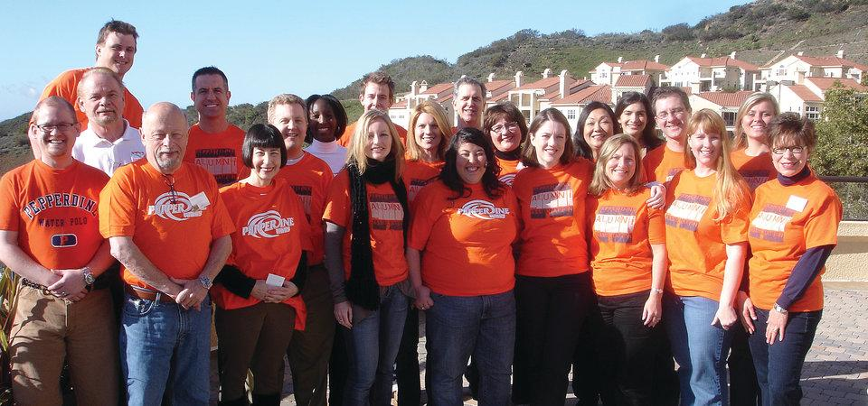 Photo of Pepperdine faculty and staff volunteering in orange Pepperdine shirts