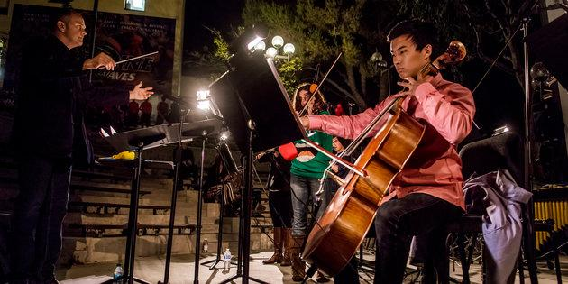Music majors play the cello during a student concert - Music Degree