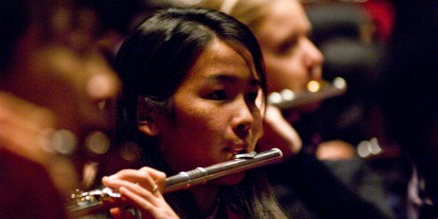 Music majors play the flute during a student concert - Music Degree