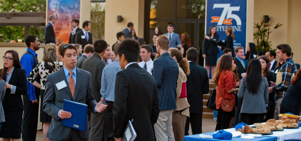 Pepperdine students networking on the Malibu campus