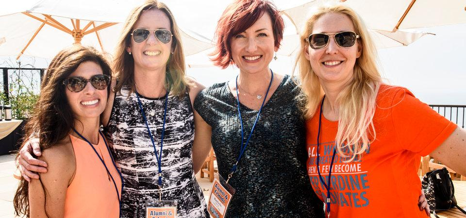 Photo of four women embracing one another at Waves Weekend