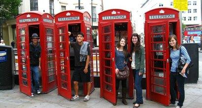 Five Seaver students outside a red telephone booth in London, England