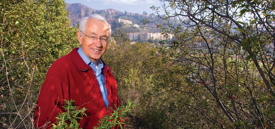 Seaver professor with a red jacket photographed in the Santa Monica mountains