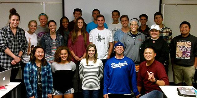 Sport administration students gather in a classroom - Sport Administration Degree