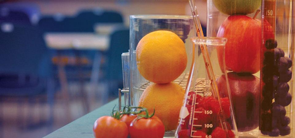 Nutritional science lab with fruit in beakers