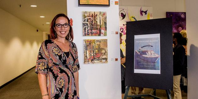 Seaver alumni standing alongside her artwork during Waves Weekend