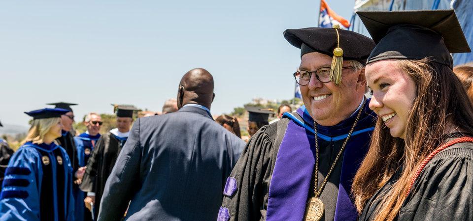 a Seaver student at graduation with President Benton