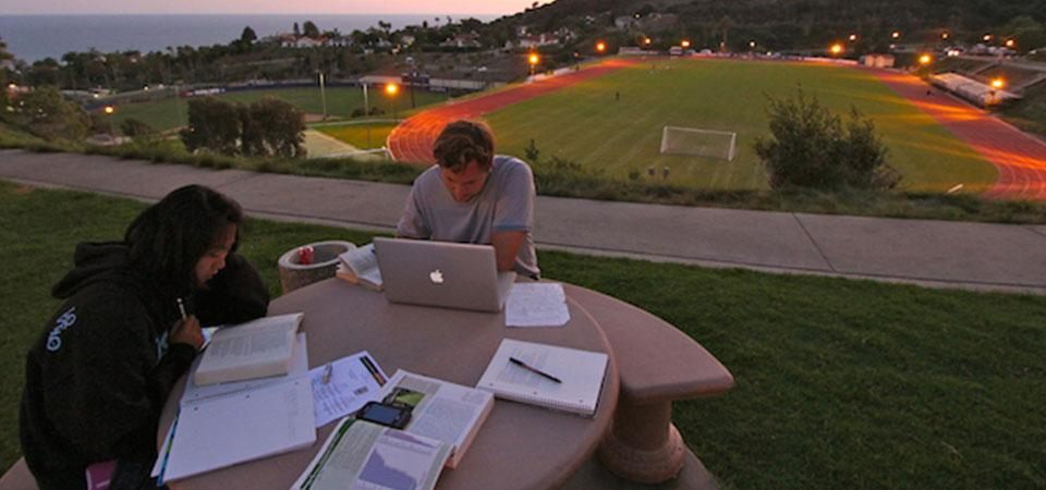 two Seaver students studying outside