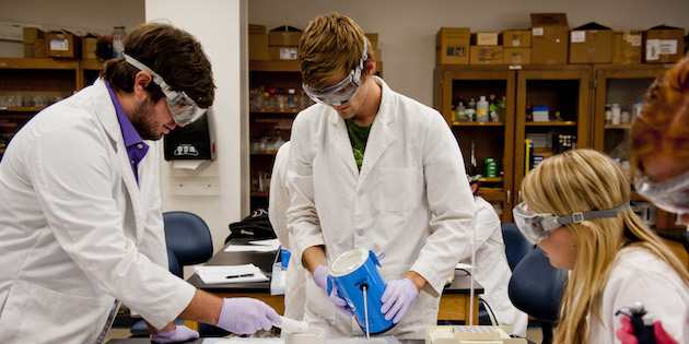 Chemistry majors wear gloves and goggles to work with chemicals - Chemistry Degree