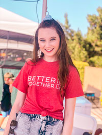 Erin Miller pictured in a red t-shirt that reads Better Together