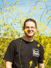 Noah Racy pictured amongst yellow wildflowers