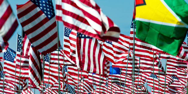 American flags wave alongside those of other countries