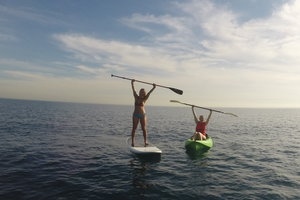 two Pepperdine students paddleboarding